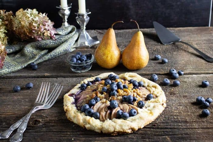 overhead shot of rustic pear and blueberry galette