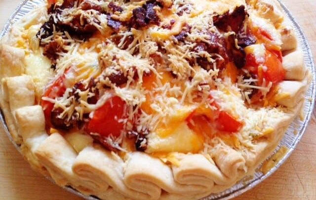 This is the Best 5 Layer Tomato Pie Recipe that makes up in minutes, with only 6 main ingredients plus a baked pie shell! Just like a BLT but in a pie crust, This 5 Layer Tomato Pie will become a staple in your meal planning.