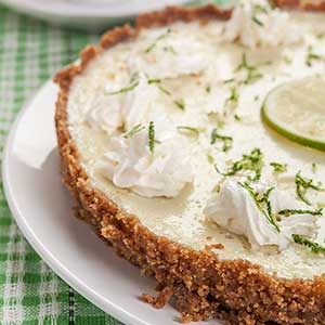 key lime pie side view slice of lime on top, easy key lime pie recipe