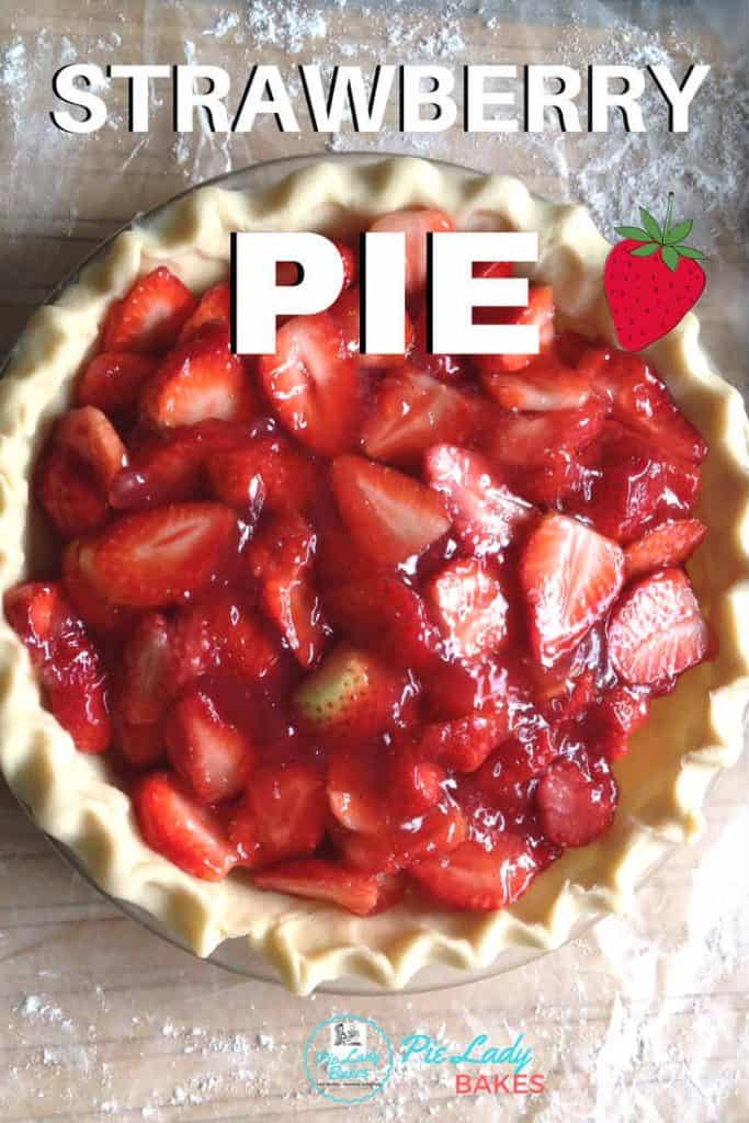 overhead image of fresh strawberry pie filling in a pie crust ready to bake with white block letters that spell out strawberry pie