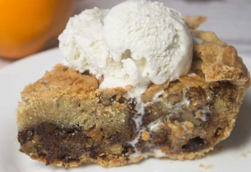 close up image of chocolate chip cookie pie with shortcrust pastry and ice cream