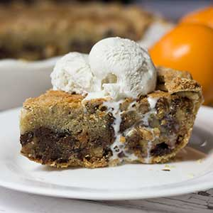 Chocolate Chip Cookie Pie. How perfect is that? Made with two kinds of chocolate chips and a splash of Grand Marnier, this pie has the chewy, chocolate-y goodness of a warm chocolate chip cookie, baked inside flaky pie crust.