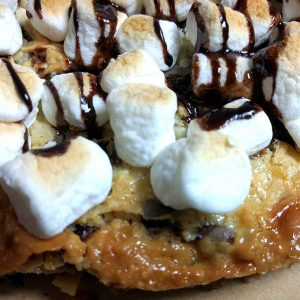 S'mores Magic Cookie Bar Pizza. The ooey gooey combination of chocolate, coconut, and graham crackers topped with a thick layer of sweetened condensed milk – oh wow!  You know what I mean!