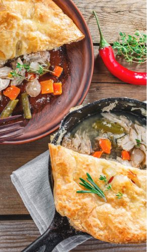 Easy Chicken Pot Pie with serving removed on a brown plate and brown fork