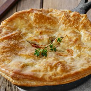 Chicken Pot Pie in Puff Pastry baked in a cast iron skillet