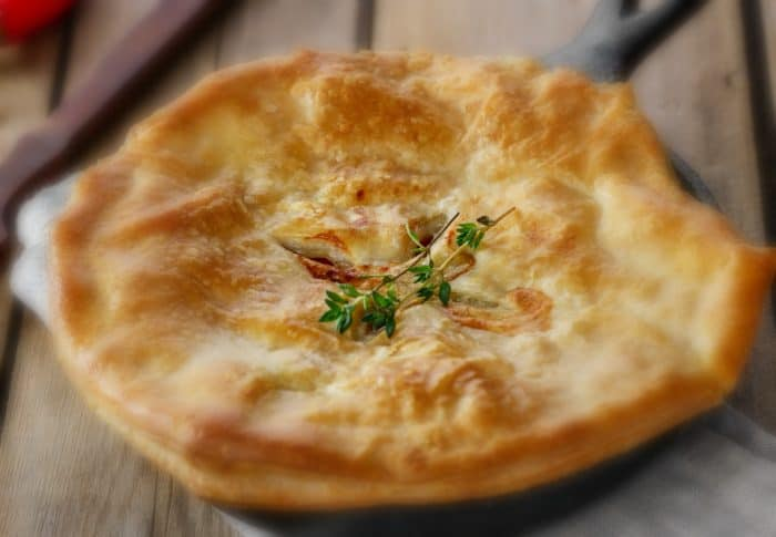 chicken pot pie with puff pastry to crust, baked in a cast iron skillet