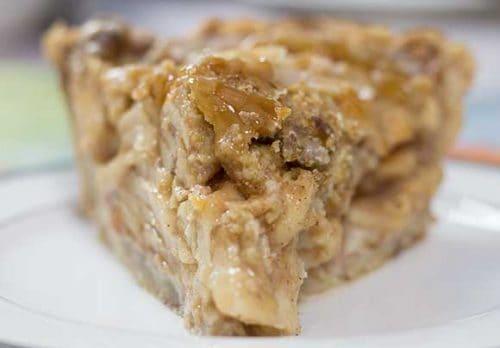 Slice of Dutch Apple Pie in white pie plate