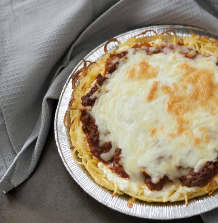 Easy Spaghetti Pie Casserole, an easy under 30 minutes supper dish that you can make ahead and freeze. These mini spaghetti pies are great for lunches!