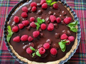 An easy and elegant recipe, this Chocolate Raspberry Tart on a Sugar Cookie Crust is a showstopper and only you will know how easy it was to make!