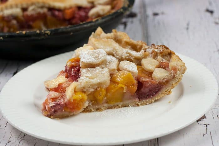 You will love this Homemade Peach Mango Sangria Skillet Pie, full of everything you put in Sangria, it's a burst of summertime right in your mouth.