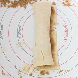 pastry dough has been rolled on a pie crust rolling mat
