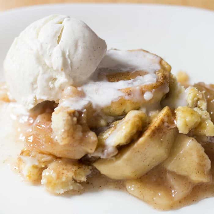 Cinnamon Swirl Apple Cobbler takes a classic apple crisp recipe and gets all dressed up with a delicious cinnamon swirl pie crust topping! So easy to make and a perfect way to use leftover pie crust. Like Cinnamon Pastry met Apple Crisp and fell in love.