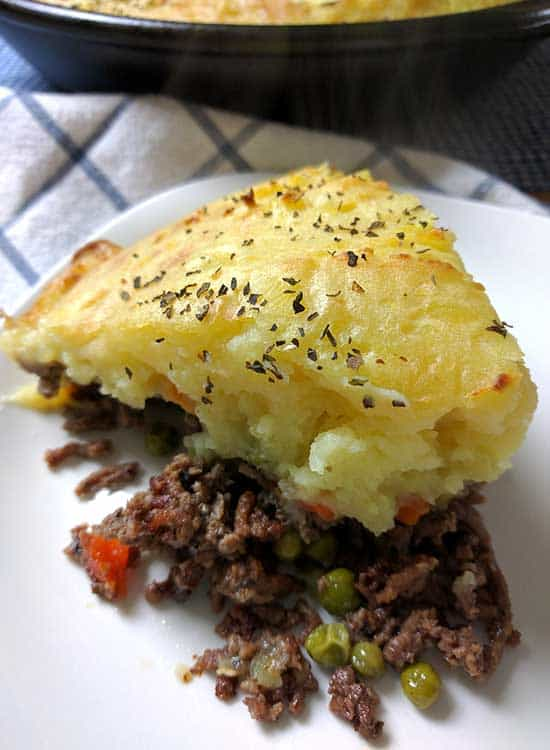 A family favorite, this Easy Homemade Shepherd's Pie recipe is the ultimate comfort food that can feed an army, or be perfect for lunch time leftovers.  It's really just a casserole with layers of ground beef, vegetables and creamy mashed potatoes.
