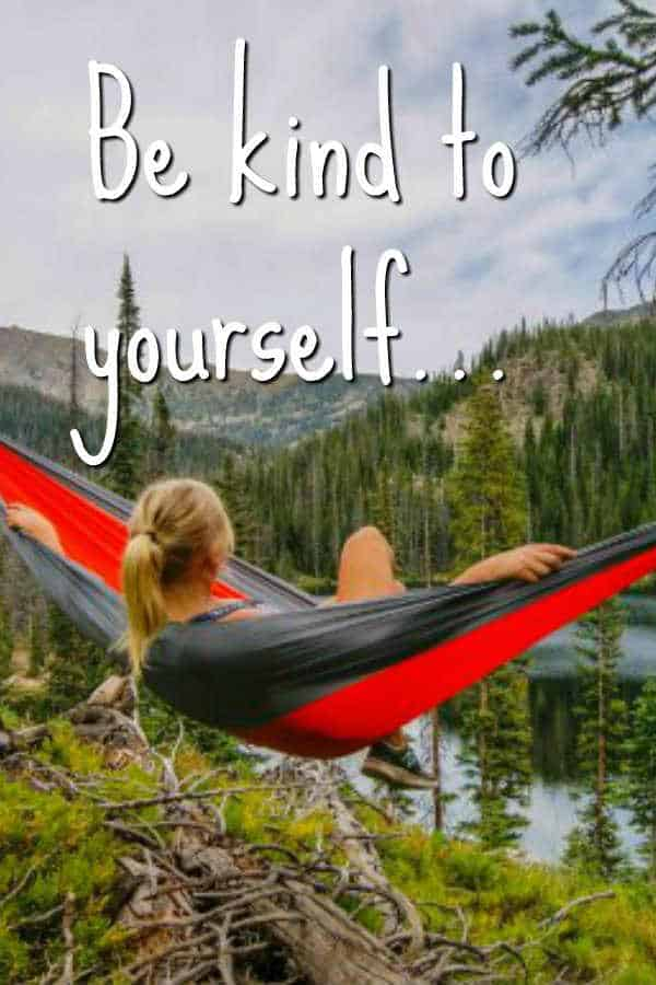 woman on hammock with words be kind to yourself