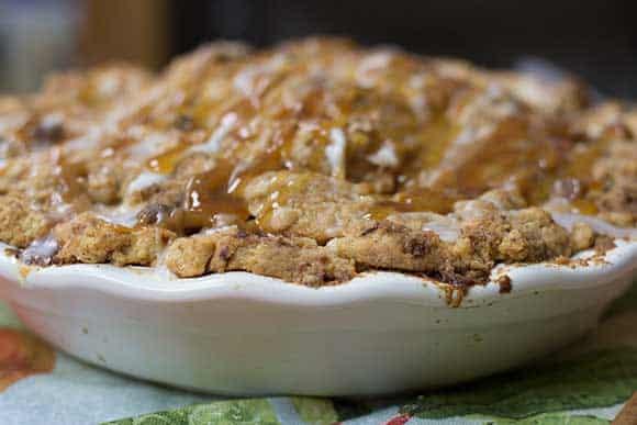 Dutch Apple Pie in white pie plate on printed tea towel