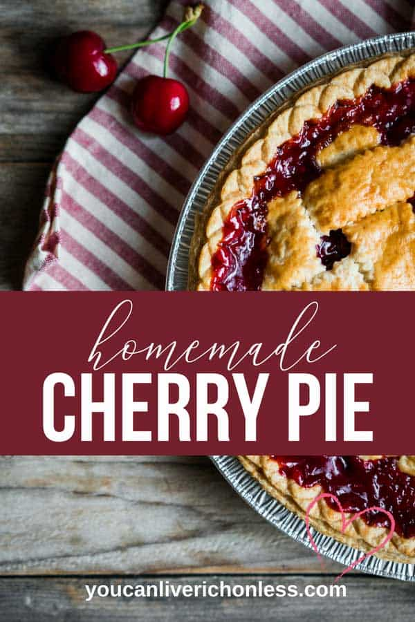 side view of baked cherry pie in a tin pie plate with two fresh cherries on red & white striped napkin.  white text on red background says homemade cherry pie