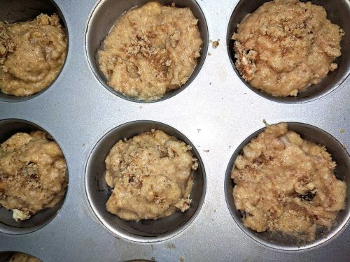 banana muffin batter in muffin tin