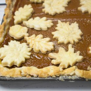 Pumpkin slab pie is a great dessert that just keeps on giving! It will definitely feed a crowd of folks and then some! And it's absolutely delicious eaten cold for breakfast. An easy pumpkin pie recipe, that's double to fit on a cookie sheet or jelly roll pan, and you can use these cute pie crust leaf cutters!