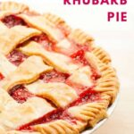 overhead image of rhubarb pie with strawberries lattice pie crust with red letters spelling out strawberry rhubarb pie