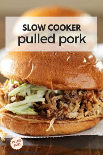 two pulled pork sandwiches with colesalw and bbq sauce on dark wooden table