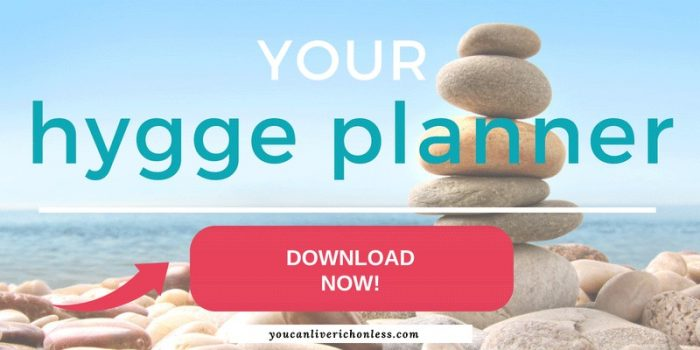 tower of stones on a rocky beach with the text your hygge planner download now!