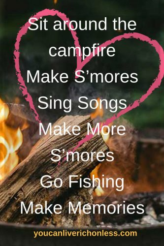 "campfire in the background large pink heart with the text ""Sit around the campfire Make S'mores Sing Songs Make More S'mores Go Fishing Make Memories"""