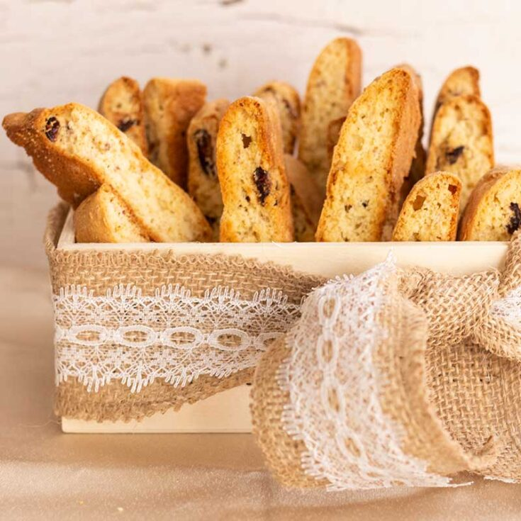biscotti standing in a small box with a jute and lace ribbon