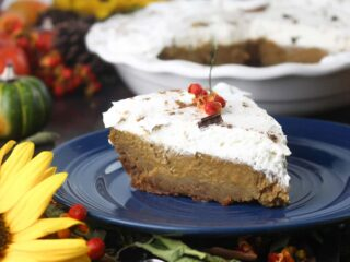 slice of kahlua pumpkin pie on blue plate