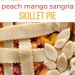 lattice top peach mango pie with text that reads peach mango sangria skillet pie
