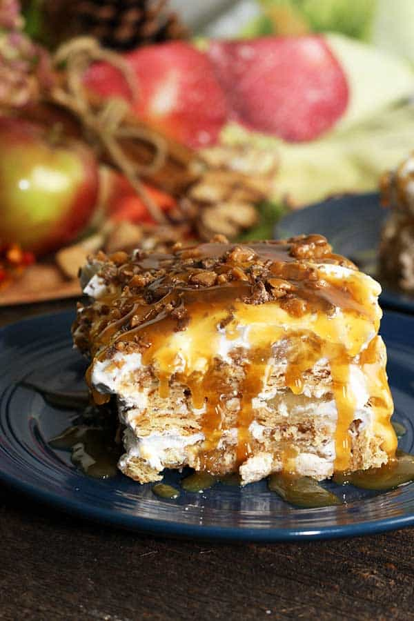 slice of apple pie cheesecake lasagna with caramel sauce