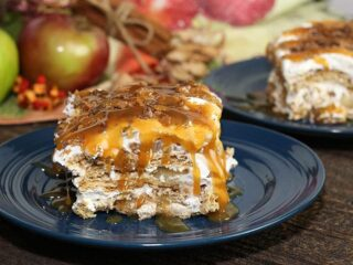 slice of apple pie cheesecake lasagna on blue plate