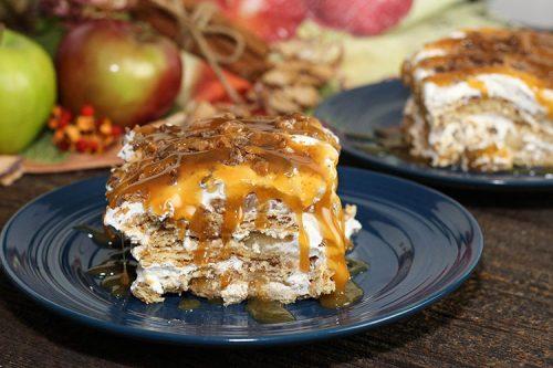 slice of apple pie cheesecake lasagna on blue plate