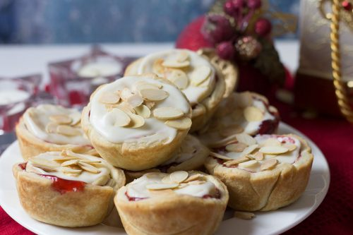 plate of cranberry cherry tarts with almond glaze