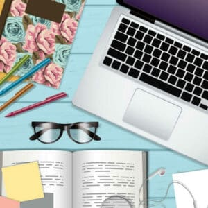 hygge at work on purple background, middle photo of office flat lay includes laptop, journal, open book, glasses, highlighter and smart phone bottom text reads live hygge every day