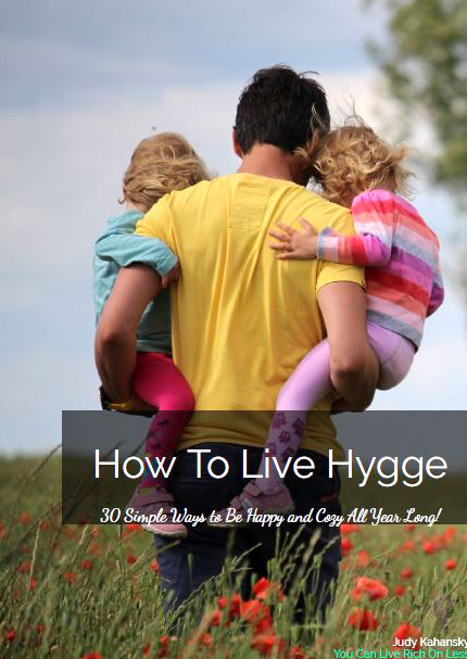 how to live the hygge lifestyle ebook picture of man holding two small children walking in a field
