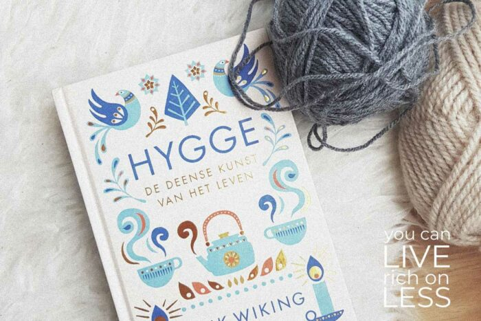 the little book of hygge the danish way to live well on white background with grey and cream colored yard in top right corner