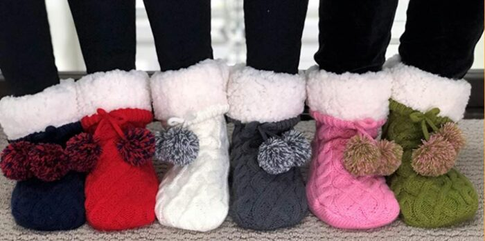 collection of knitted slipper socks cozy hygge gifts