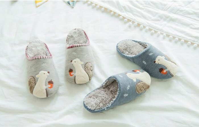 two pairs of slippers with squirrel motifs sewn on them for a cozy experience