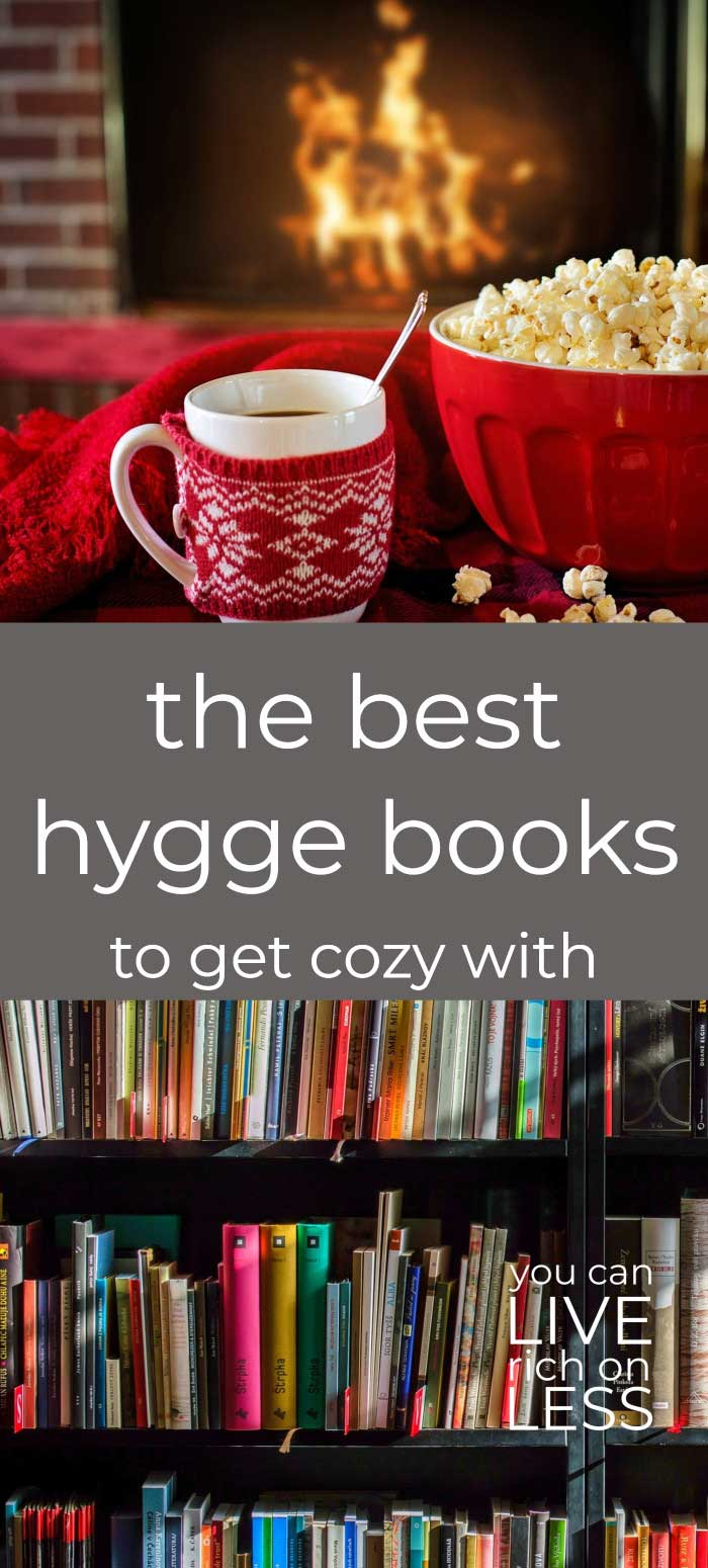 red mug and red bowl of popcorn in front of a fireplace, on top of image showing multi colored books on shelves with text that read the best hygge books to get cozy with