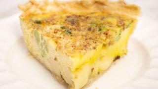 broccoli quiche slice on a white plate