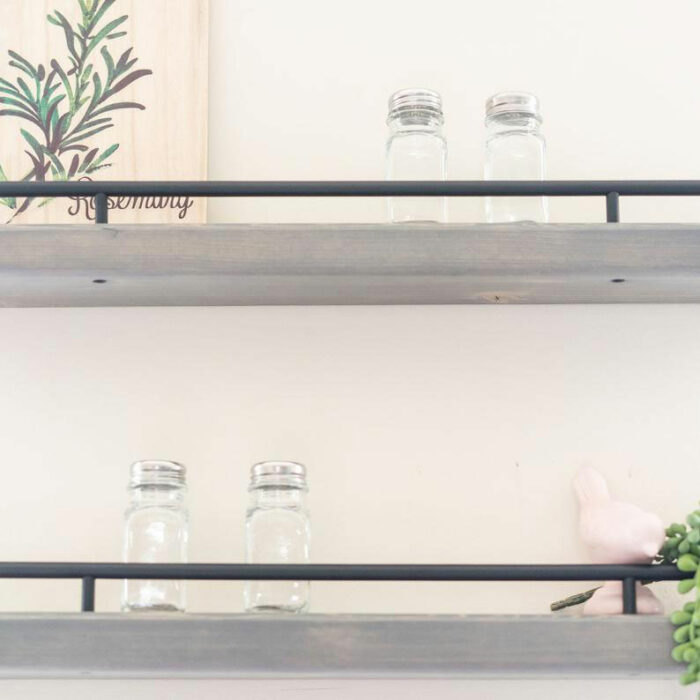 floating shelves with spice jars and pictures on them