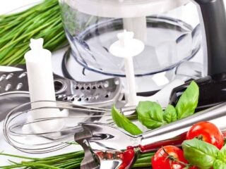 food processor and attachments with chives and cherry tomatoes