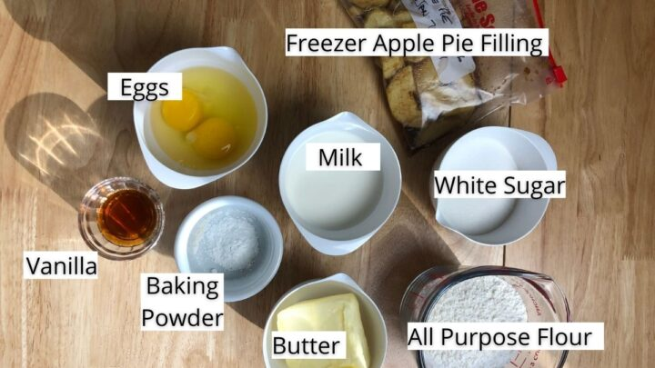 image shows ingredients for apple bread with labels, vanilla, baking powder, eggs, milk, freezer apple pie filling white sugar, butter, all purpose flour
