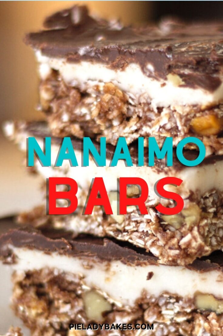 stack of 3 nanaimo bars on a white table blurred background