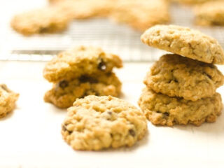 7 ranger cookies displayed in front of a cooling rack with more cereal cookies on it blurry background feature