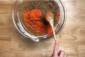easy carrot cake recipe mixing in carrots and pecans