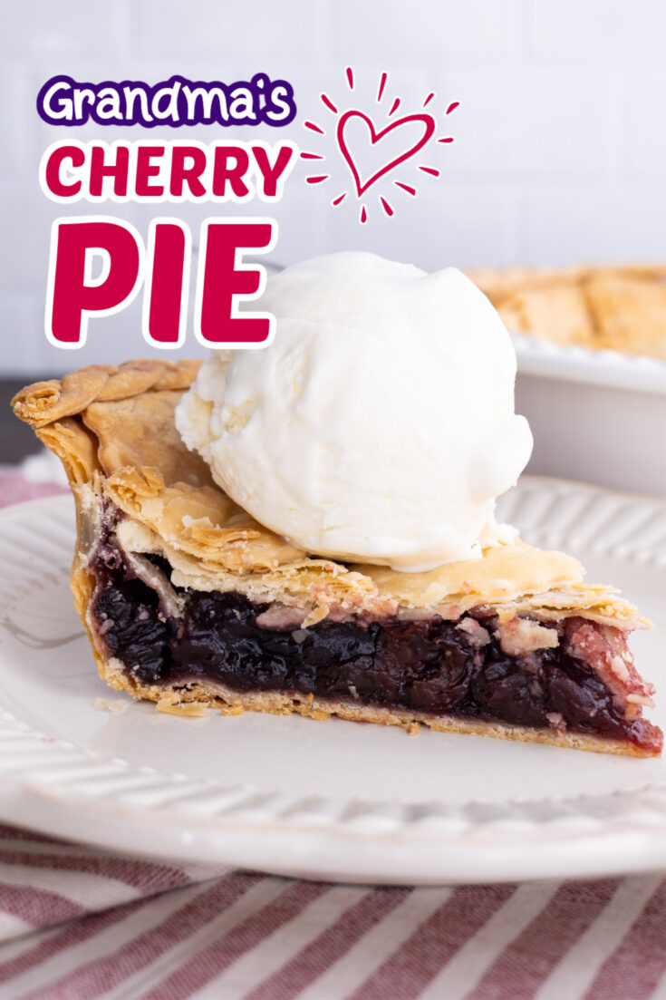 slice of cherry pie on a white plate with a scoop of vanilla ice cream on top, white plate on a red & white striped table runner