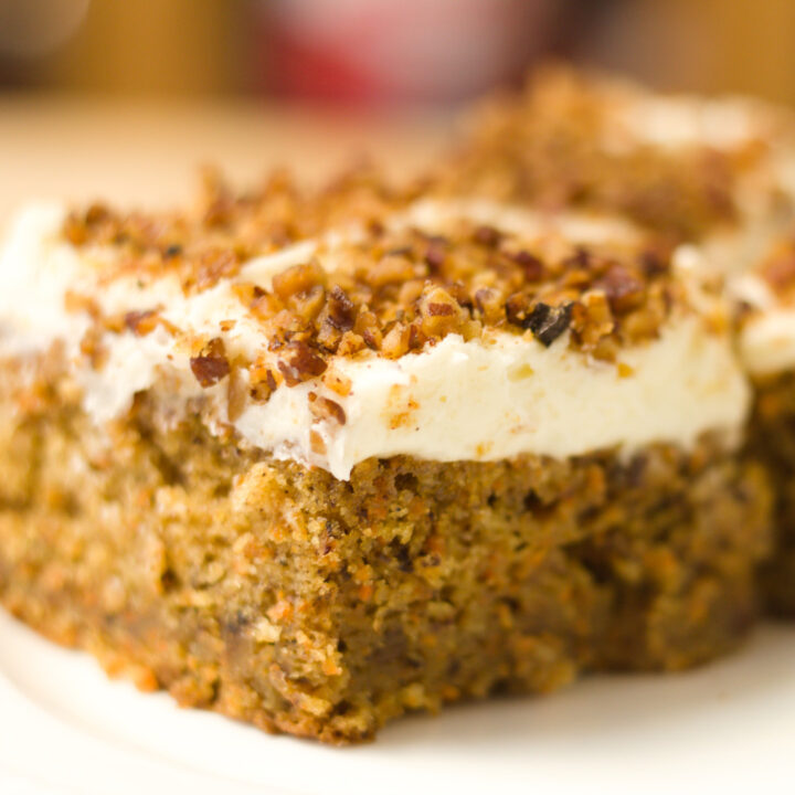 carrot cake recipe with cream cheese and toasted pecans on top