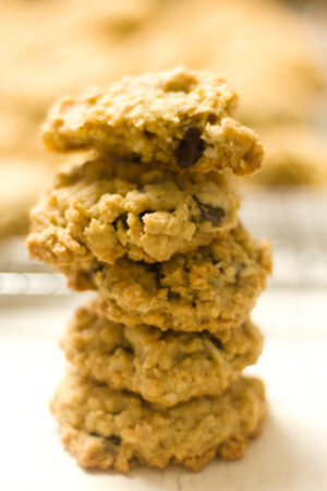5 ranger cookies in a stack with blurred background