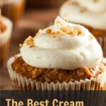 closeup of carrot cake cupcake with cream cheese frosting sprinkles with pecans